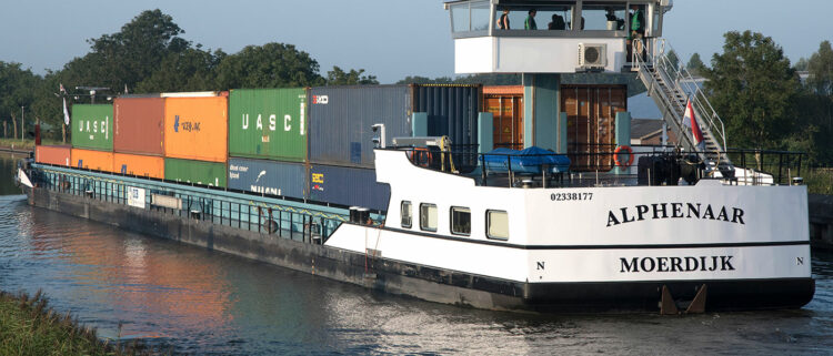 Zero emission container barge in commercial service. Photo: ZES